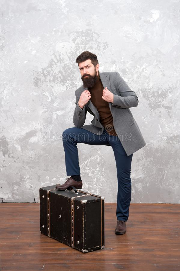 Best travel bags for men. Guy well groomed elegant bearded man and vintage suitcase. Time traveller concept. Vintage stock photography