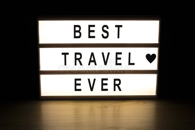 Best travel ever light box sign board. On wooden table royalty free stock photos
