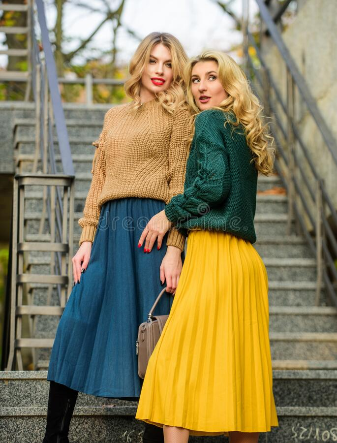 Best vacation. fall season color trends. Pleated trend. girls in corrugated skirt and sweater. female beauty. knitwear. Fashion for youth. charm. stylish autumn royalty free stock photos