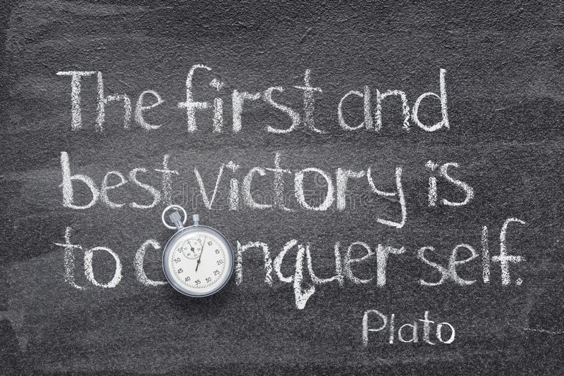 Best victory Plato. The first and best victory is to conquer self - quote of ancient Greek philosopher Plato written on chalkboard with vintage stopwatch royalty free illustration