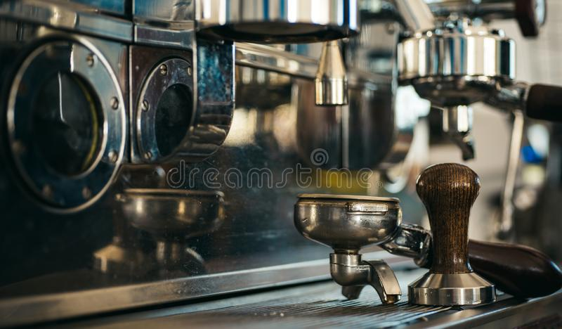 The best way for your coffee to be brewed. Metallic cooking appliance to brew coffee. Portafilter of espresso machine. With tamper. Coffee machine. Coffeehouse royalty free stock photos