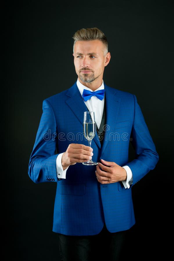 Best wishes. Champagne cheers. Man in suit corporate party. Boss director top manager hold glass champagne. Business stock photography