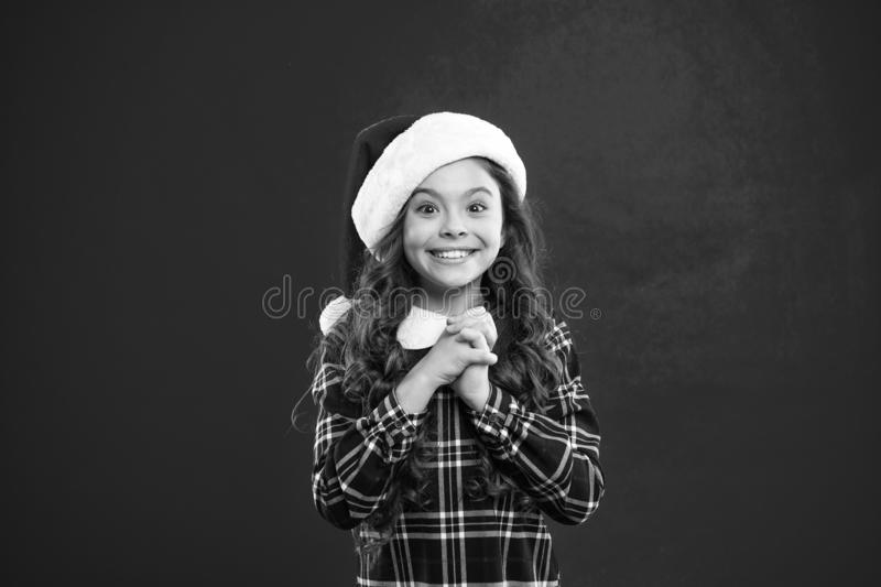 Best wishes. Little girl child in santa red hat. Christmas shopping. Happy winter holidays. Small girl. Present for Xmas. Childhood. New year party. Santa stock image