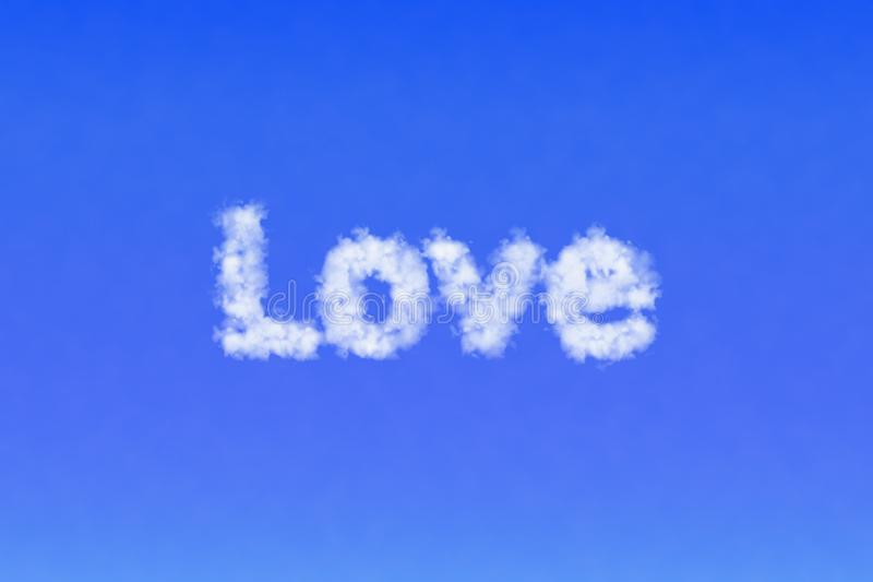 Word Love from the clouds in the sky. Be in love concept. royalty free stock image