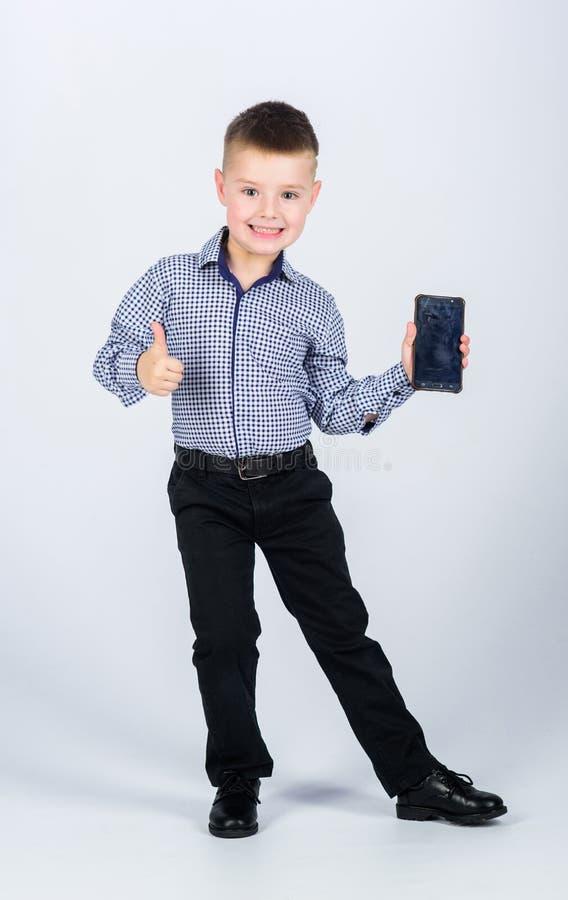 Beste apparaat ooit Kinderjaren Bedrijfs mededeling r Het moderne leven Weinig werkgever stock foto