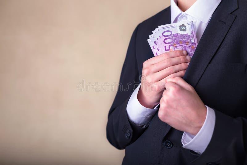 Bestechungsgeld und Korruption mit Eurobanknoten lizenzfreie stockbilder