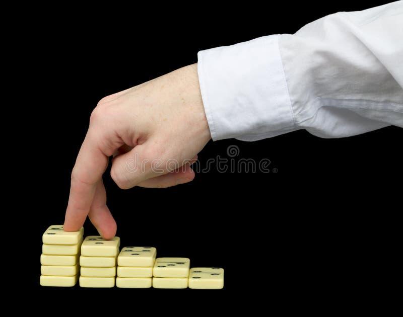 Besteigung auf einem Bedienpult von den Dominos lizenzfreie stockfotos