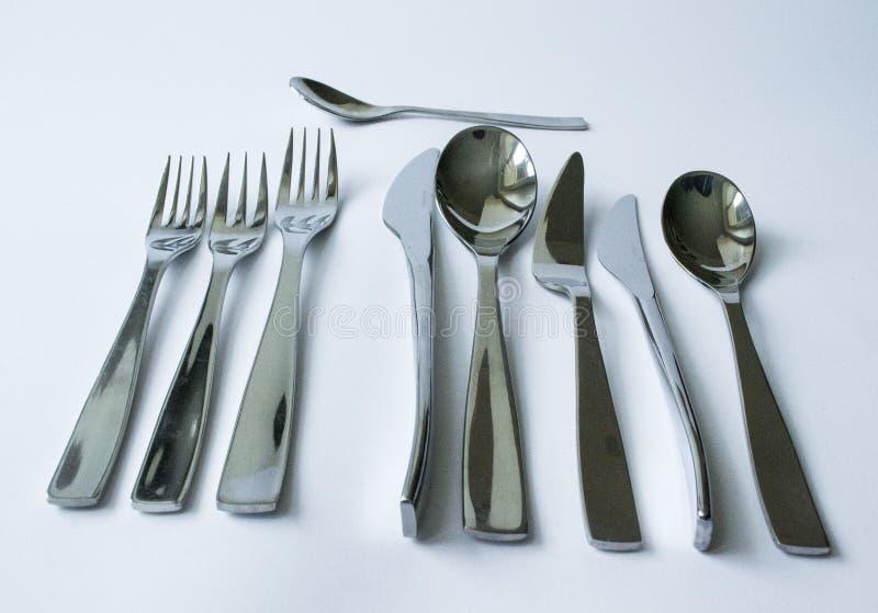 Bestek, vorken, lepels en messen stock foto's