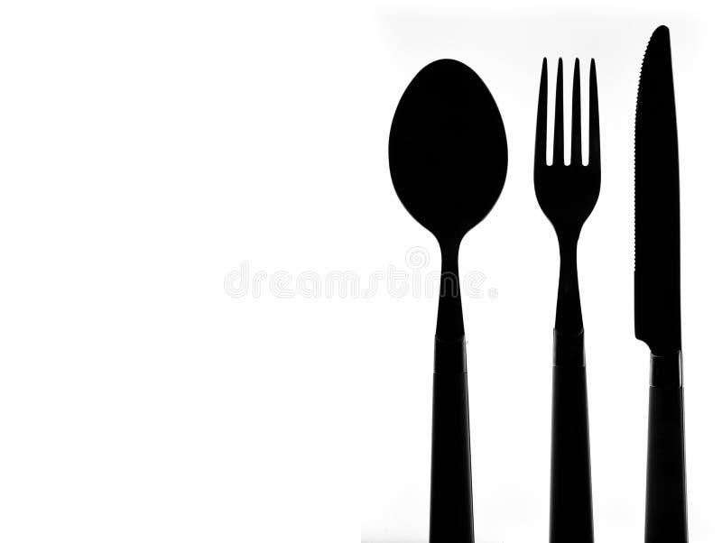Bestickkontur över vit bakgrund Sked, gaffel och knive arkivfoton