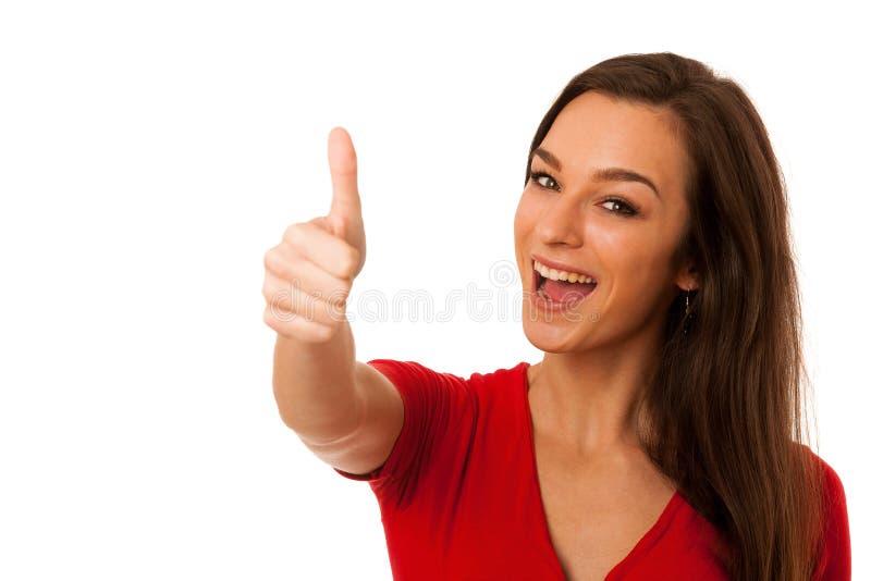 Besutiful打手势与显示的女商人赞许的成功 免版税库存图片