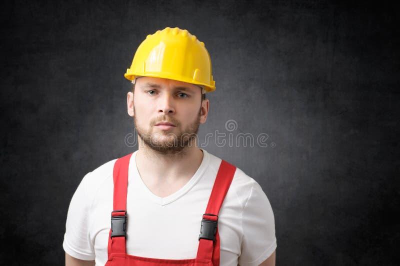Besviken byggnadsarbetare royaltyfri foto