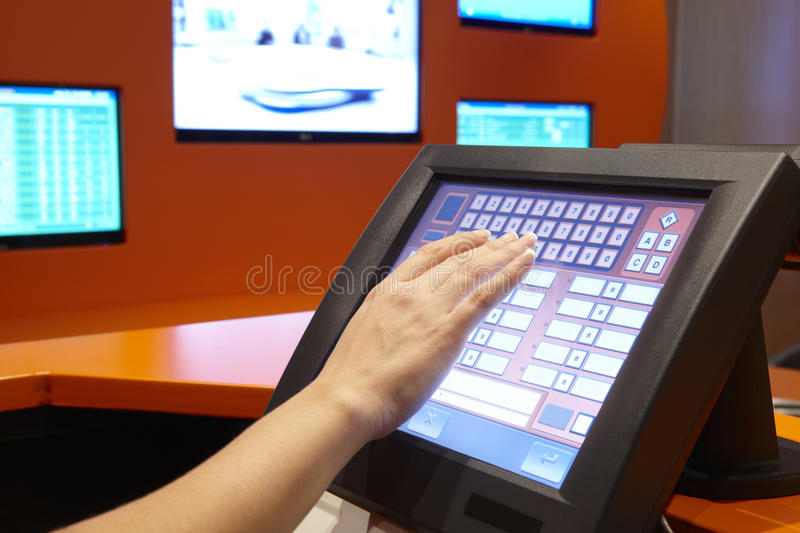 Bet machine with female hand ready to operate. Horizontal stock image