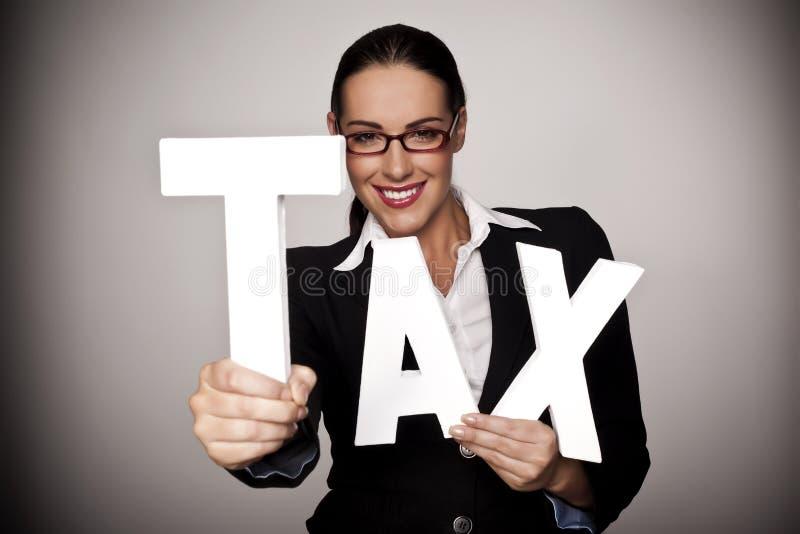 Betaal uw belasting. stock afbeelding