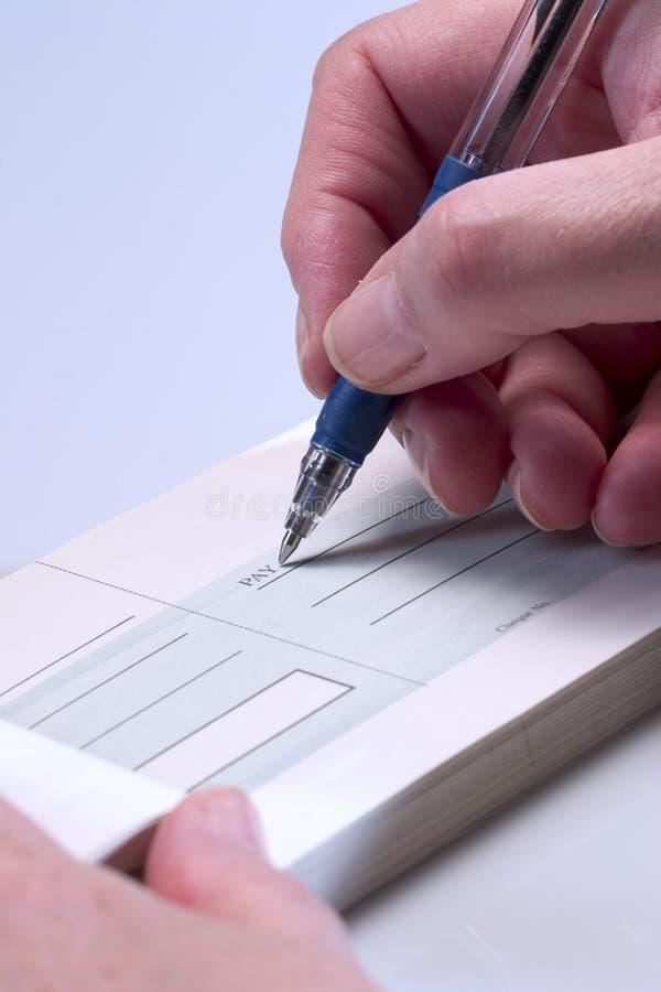 Betaling door cheque stock foto