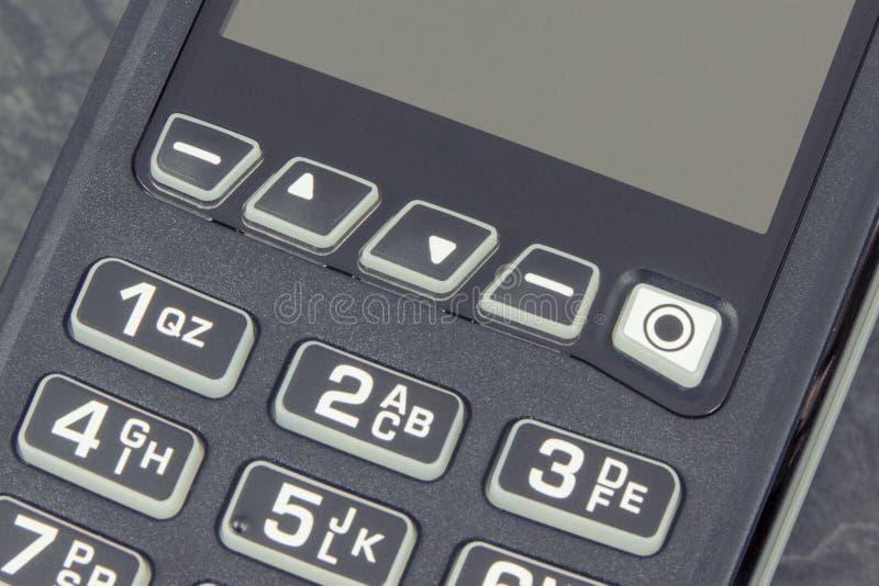 Betalningterminal genom att använda för att skriva in stiftkod Cashless betala för att shoppa arkivbilder