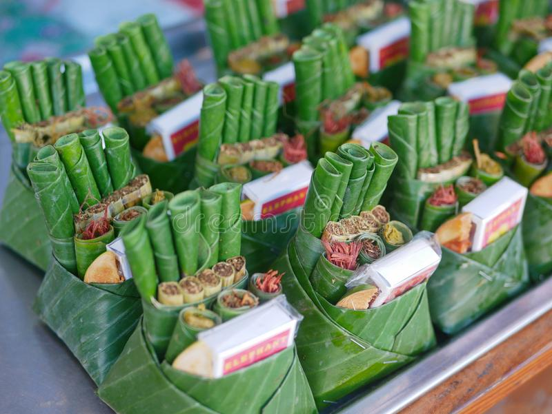 Betel nuts and leafs in handmade banana cups, as offerings for ancestor house / shrine San Pu Ya in the North of Thailand stock photos