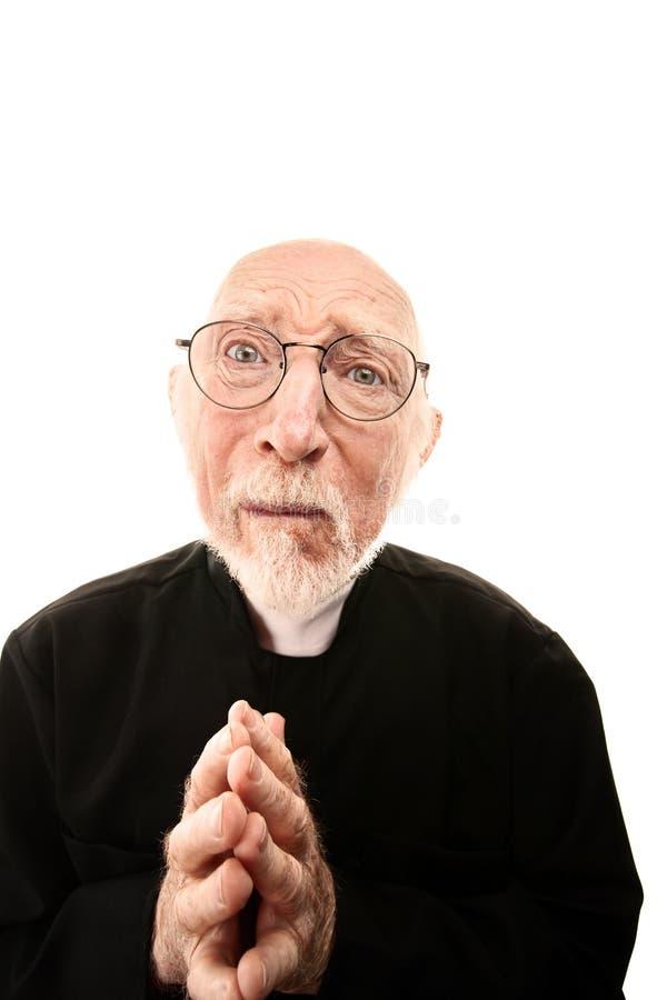 Betender Priester lizenzfreie stockfotografie