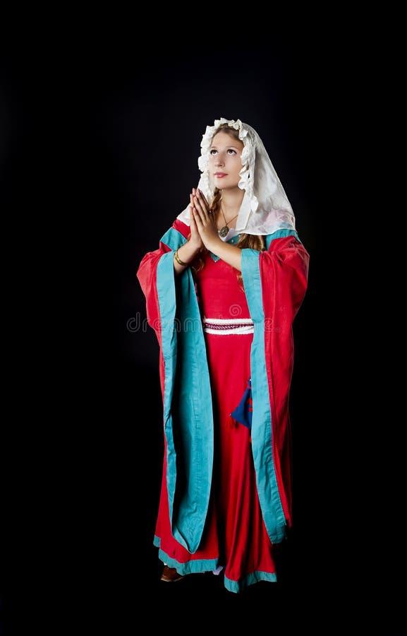 Betendes mittelalterliches Mädchen stockbild