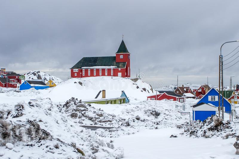 Bethel Church and Inuit village full of snow, Sisimiut & x28;Holsteinsborg& x29;, Greenland. Qeqqata architecture arctic buildings built chapel city climate royalty free stock photo