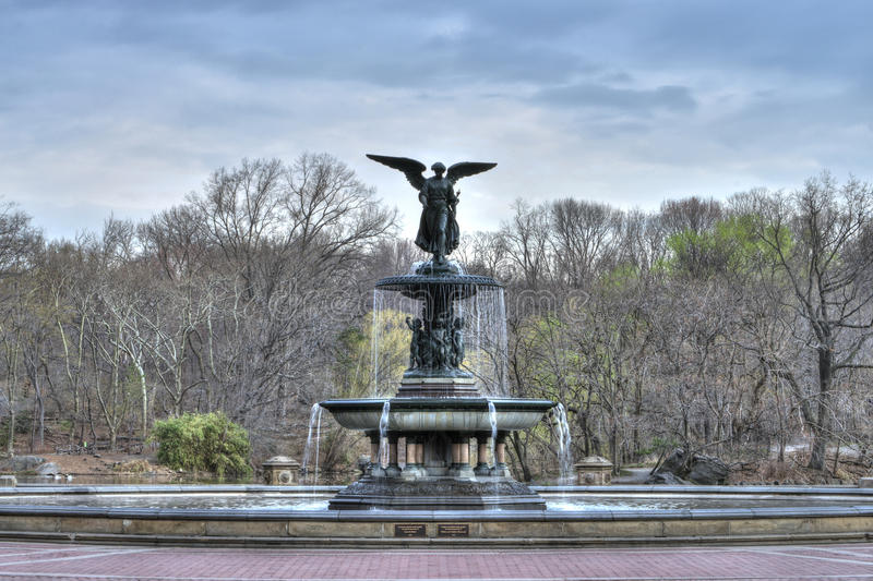 Bethesda Fountain. Beautiful Bethesda fountain in Central Park, New York on an early spring morning with bare trees in background royalty free stock photography