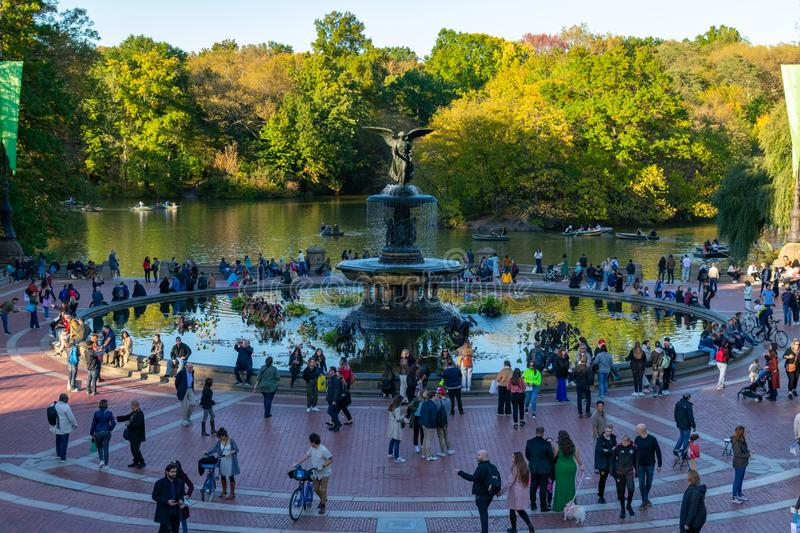 Bethesda Fountain by the Central Park Lake in New York City during Autumn. Bethesda Fountain by the Central Park Lake in the afternoon with crowds of people royalty free stock image