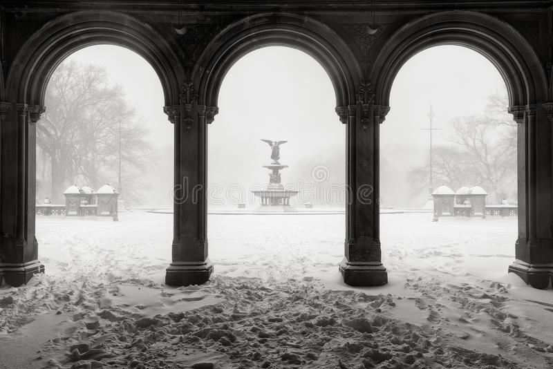 Bethesda Fountain in Central Park, Winter Snowstorm, New York City. Early morning Black & White view of the Bethesda Fountain from the Bethesda Terrace Arcade royalty free stock photo