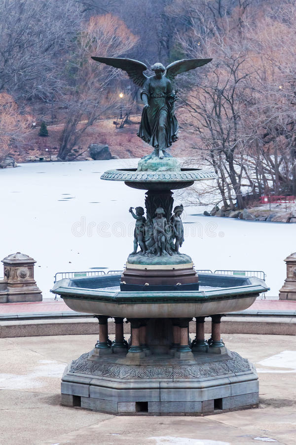 Bethesda Fountain New York City. The Bethesda Fountain with its angel statue and the frozen lake in Central Park, Manhattan Island, New York City, United States stock photo