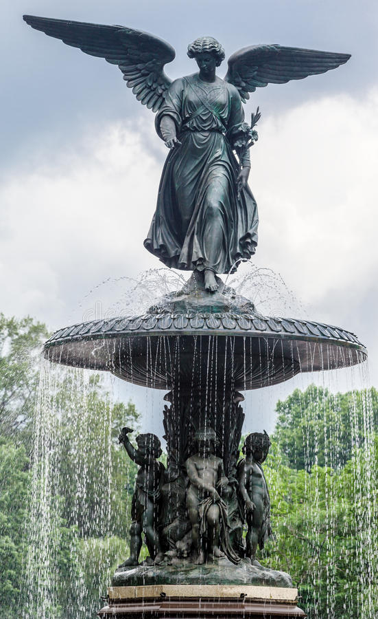 Bethesda Fountain New York City. The Bethesda Fountain with its angel statue and the frozen lake in Central Park, Manhattan Island, New York City, United States royalty free stock image
