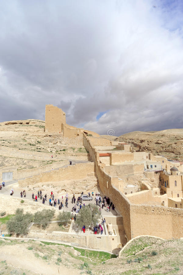 Bethlehem, Israel. - February 14.2017. View of the Lavra of Sawa Sanctified in the Judean Desert - many pilgrims at the entrance. Bethlehem, Israel. - February stock photos
