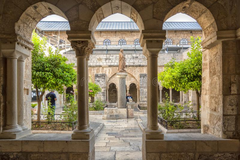 Bethlehem Israel 14th September 2017  View of the patio from the cloister through the pillars of the church or nativity. Bethlehem Israel 14th September 2017 royalty free stock photo