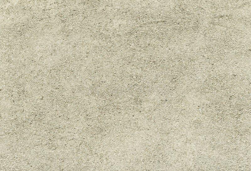 Beton- oder Zementwand mit kleinen Steinen, Beschaffenheit lizenzfreies stockbild