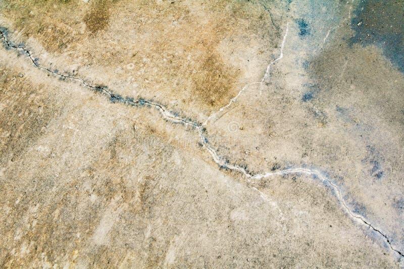 Betong för golv för skada för textur för tappningväggcement gammal för bakgrund arkivfoton