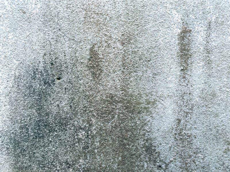 Betonmauer mit Fleck als dem Hintergrund stockbilder