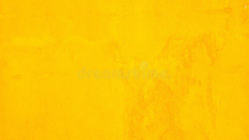 Betonowa ściana żółty kolor dla tekstury tła zdjęcia royalty free