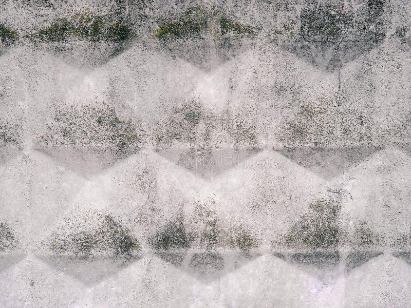 Betonowa miastowa tekstura z wzorem rhombuses i nawierzchniowa burzliwość Grunge szary miastowy tło zdjęcie royalty free
