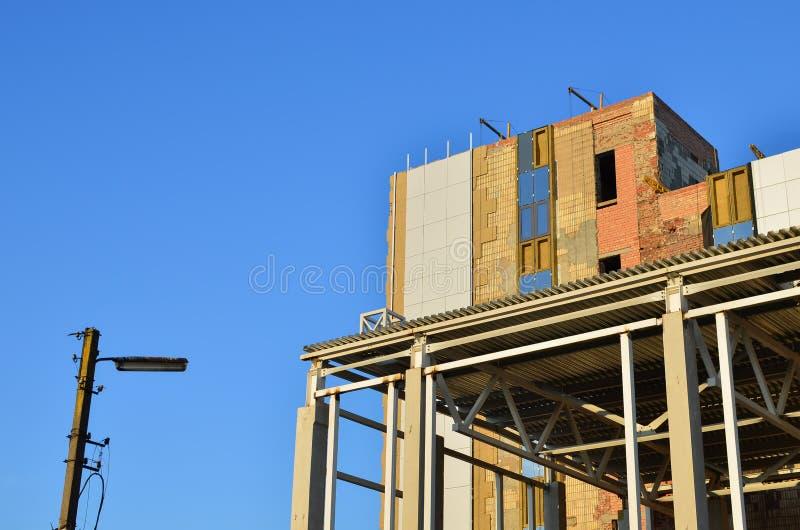 Betonowej struktury promienia kolumny cegiełka Grzać fasada, gipsować ściana z cegieł z cementem, zdjęcie royalty free