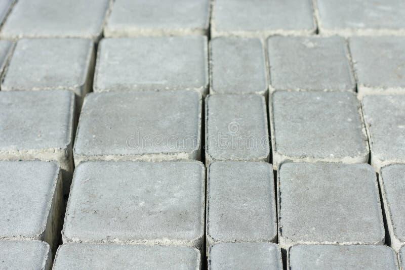 Betonowy brukowych cegie?ek pilnyak Obrazek bruku chodniczek Granitowi Brukowi kamienie fotografia stock