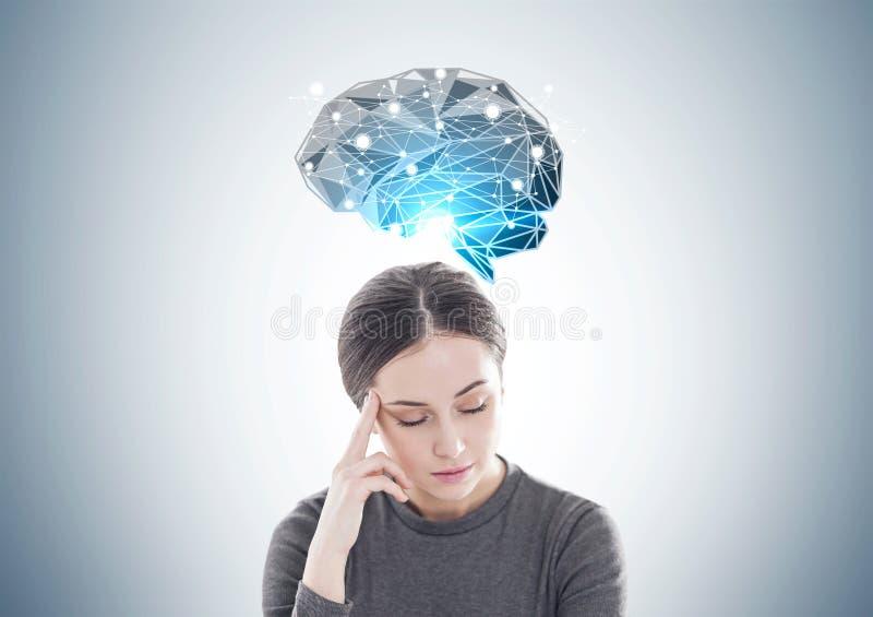 Betonte junge Frau im Braun, Gehirnstürmen lizenzfreies stockbild
