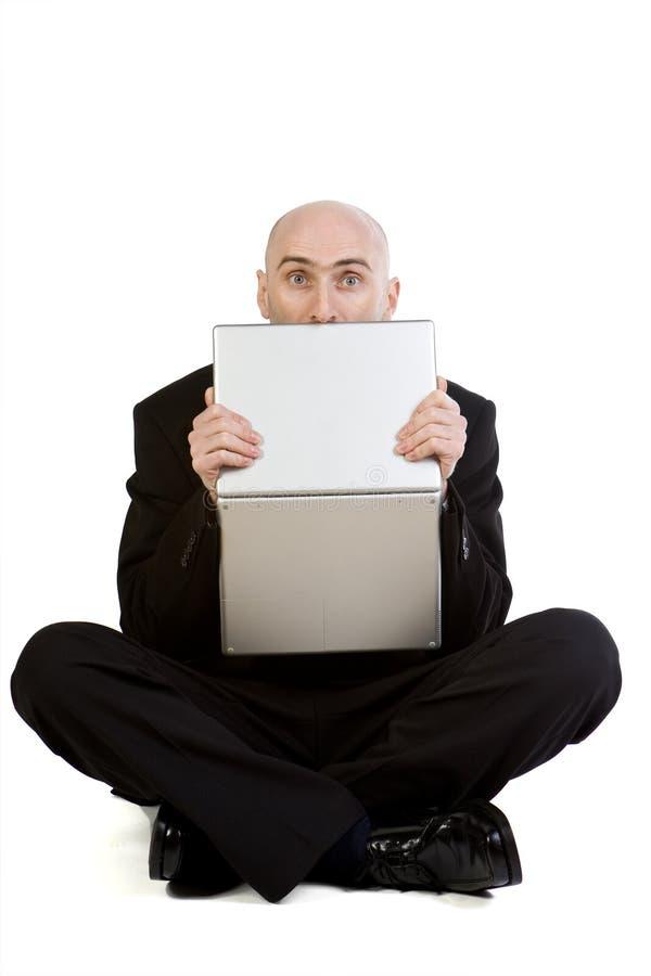 Betonter Mann u. Laptop stockbilder