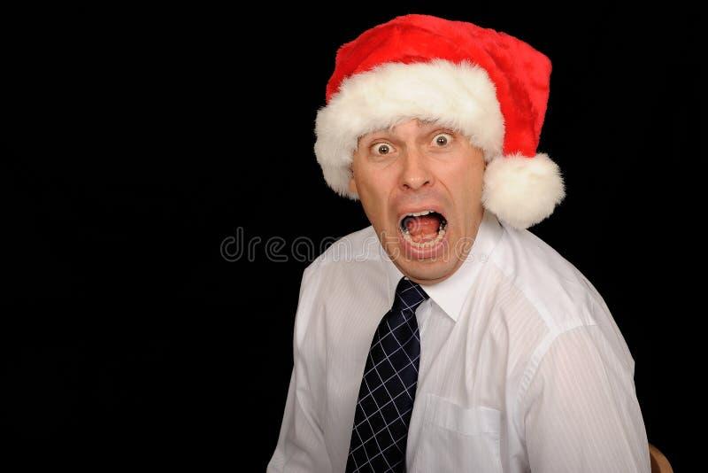 Betonter Weihnachtsgeschäftsmann lizenzfreies stockbild