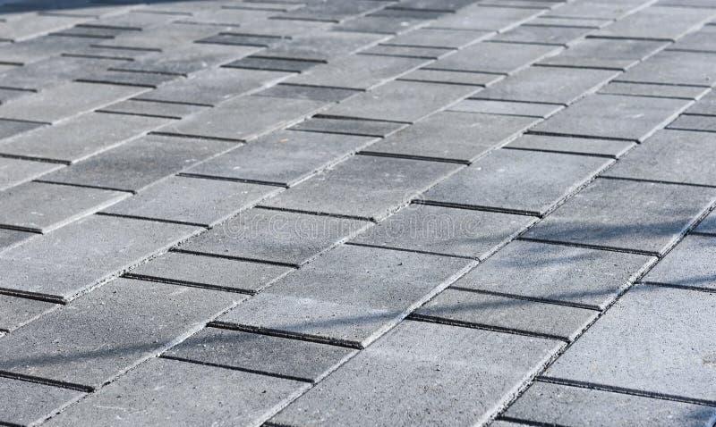 Betonuje bruków kamienie dla podłoga lub brukuje szare cegiełki lub, wal obrazy royalty free