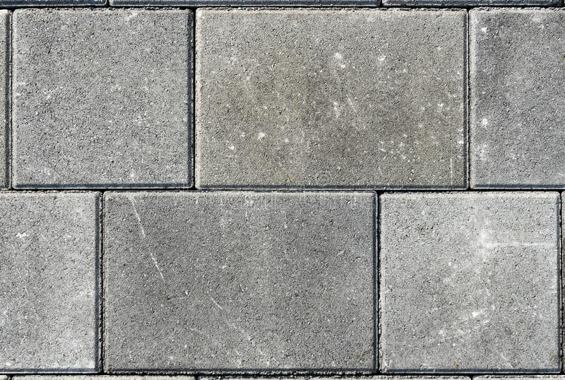 Betonuje bruków kamienie dla podłoga lub brukuje szare cegiełki lub, wal fotografia stock