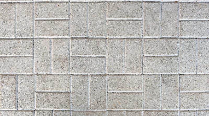 Betonuje bruków kamienie lub brukuje szare cegiełki lub fotografia stock