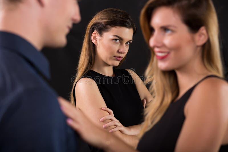 Betrayal concept. Beauty women seducing attractive man royalty free stock photography