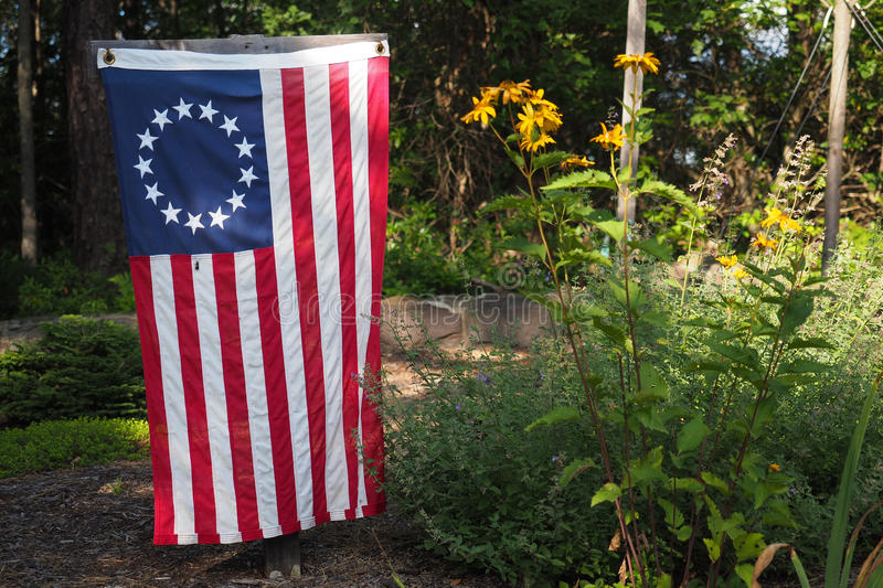 Betsy Ross Flag. A Betsy Ross flag, the first official flag of the United States, being used as a patriotic yard and garden decoration royalty free stock photo