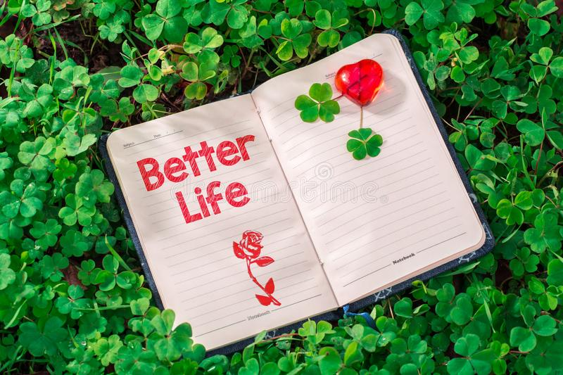 Better life text in notebook stock images