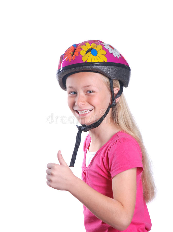 Little girl with cycling helmet on white. Portrait of a Caucasian little girl showing her thumb up because she is wearing a helmet for riding her bike safely royalty free stock image