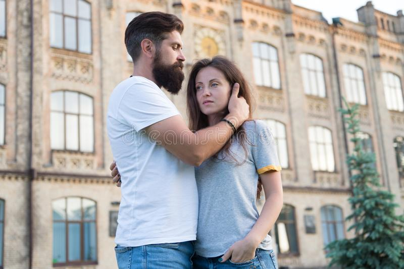 We are better when we together. Family couple hugging with building on background. Couple of bearded man and sexy woman stock photo
