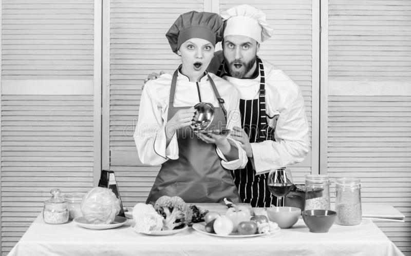 We are better when we together. surprised couple in love with healthy food. man and woman chef in restaurant. Dieting. We are better when we together. surprised royalty free stock photography