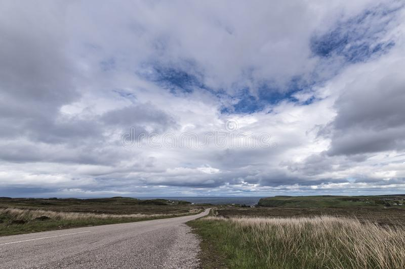 A836. The A836 between Bettyhill and Strath, part of the North Coast 500 in Sutherland, Scotland. The Orkney Islanda are in the distance royalty free stock photography